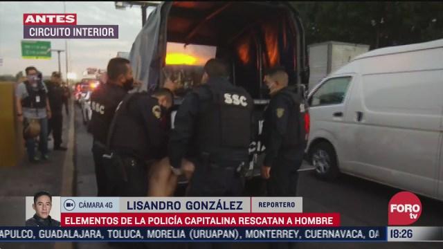 policias rescatan a hombre que se encontraba en carriles centrales del circuito interior
