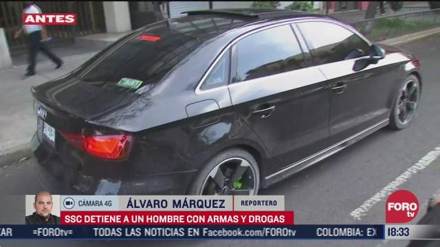 detienen a conductor de vehiculo de lujo en posesion de drogas y armas