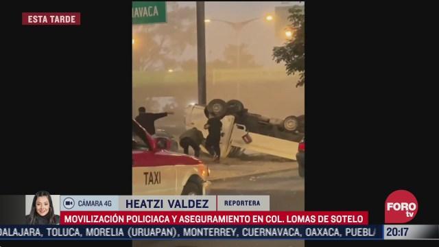 se registra movilizacion policiaca tras volcadura en lomas de sotelo