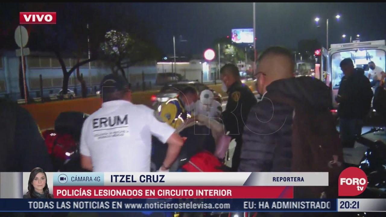 accidente vial deja policias lesionados en circuito interior