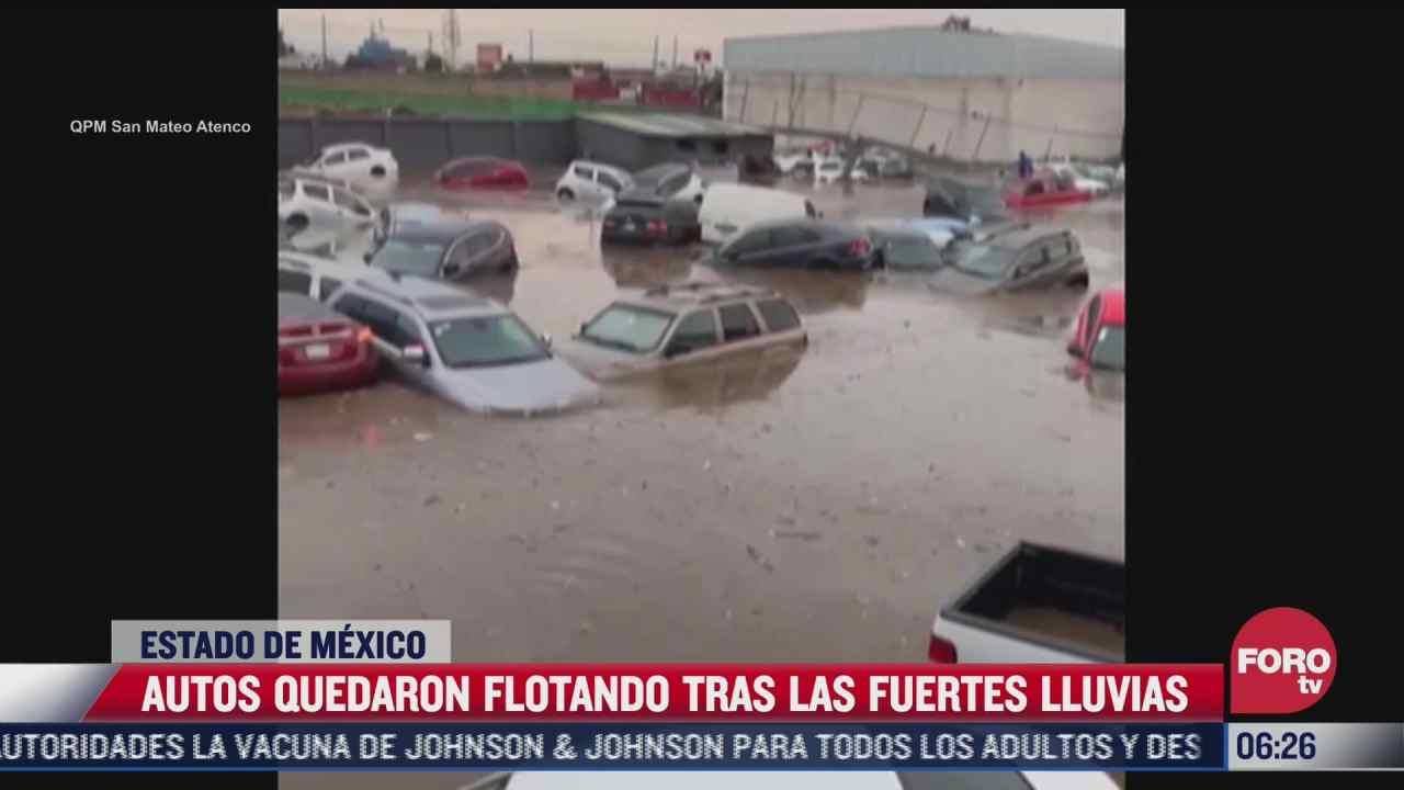 autos quedan flotando en estacionamiento inundado por fuerte lluvia en metepec