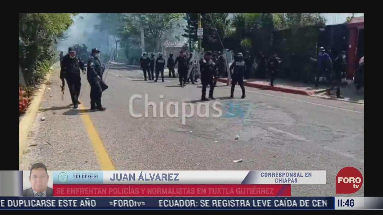 se enfrentan policias y presuntos normalistas en tuxtla gutierrez chiapas