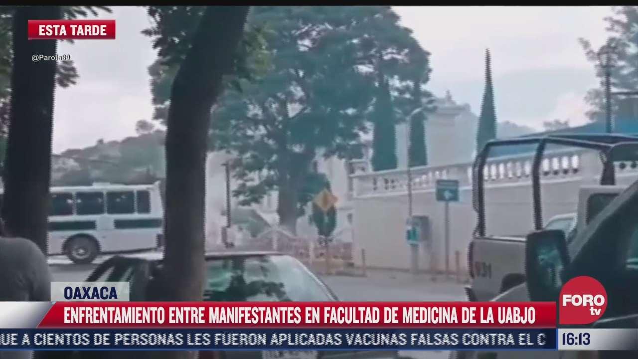 manifestantes se enfrentan por toma de la facultad de medicina de la uabj en oaxaca