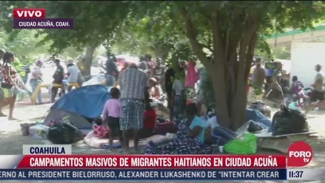 campamentos masivos de migrantes haitianos en ciudad acuna