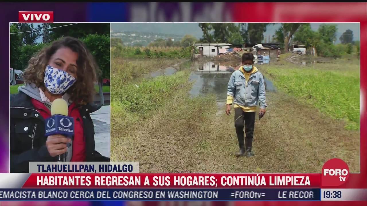 pobladores regresan poco a poco a sus hogares tras desbordamiento del rio tula