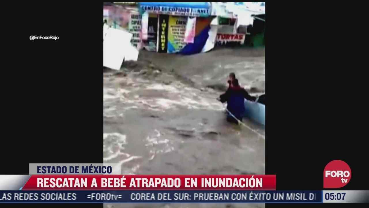 rescatan a bebe atrapado en inundacion en ecatepec