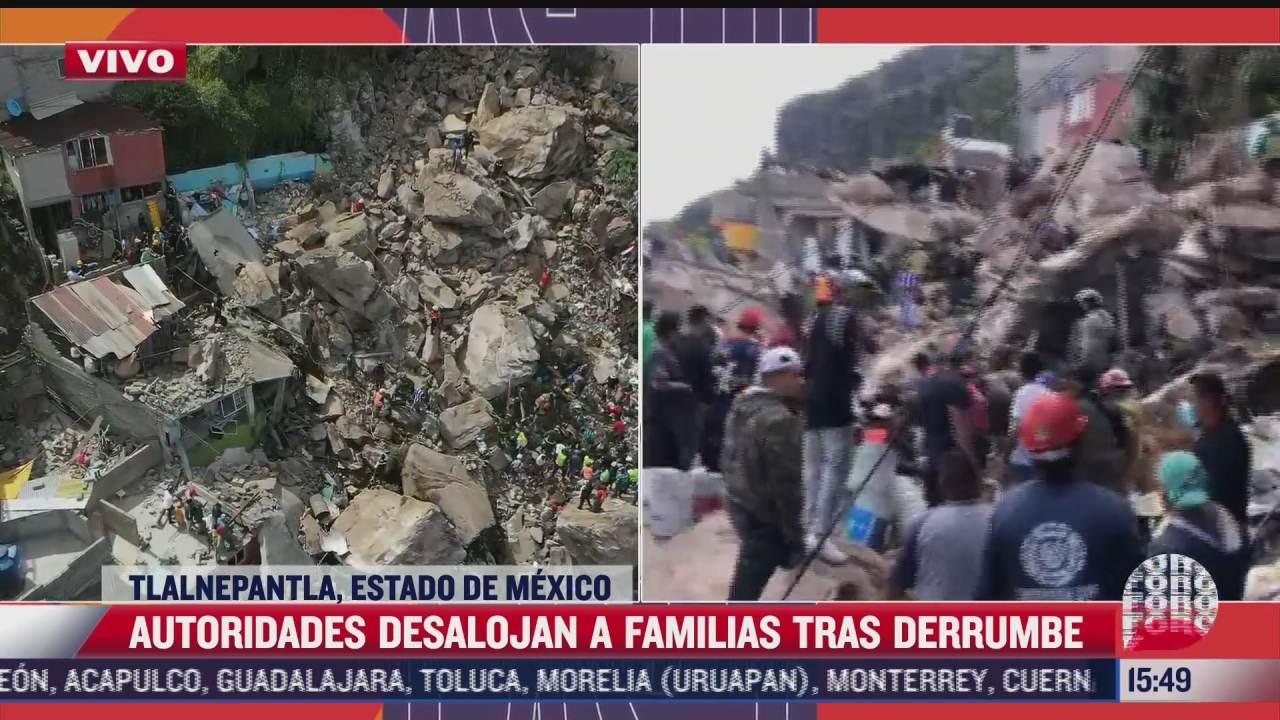 vecinos mueven piedras para buscar a personas atrapadas entre escombros del cerro del chiquihuite