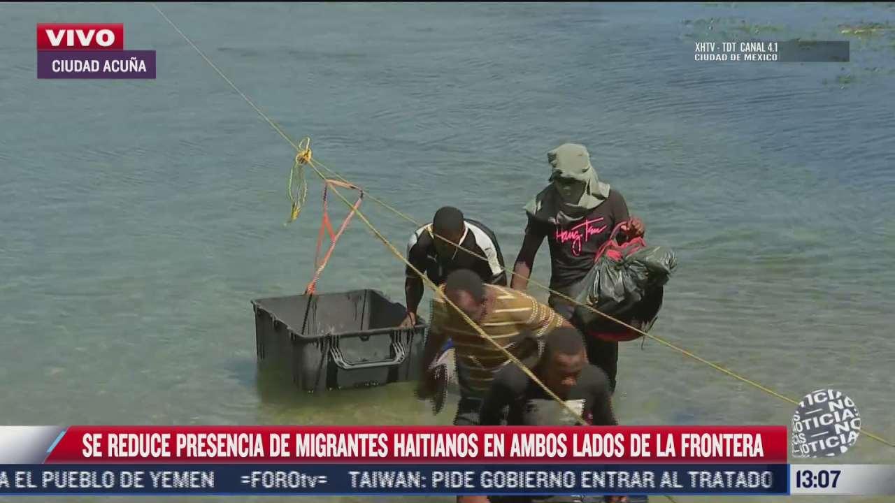 video familia de migrantes haitianos se entrega a agentes fronterizos de eeuu