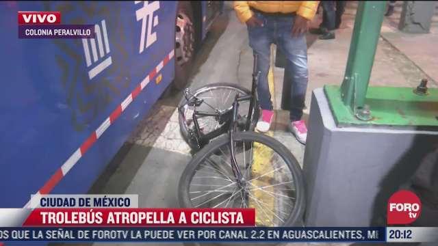trolebus atropella a ciclista sin lesionarlo sobre eje central