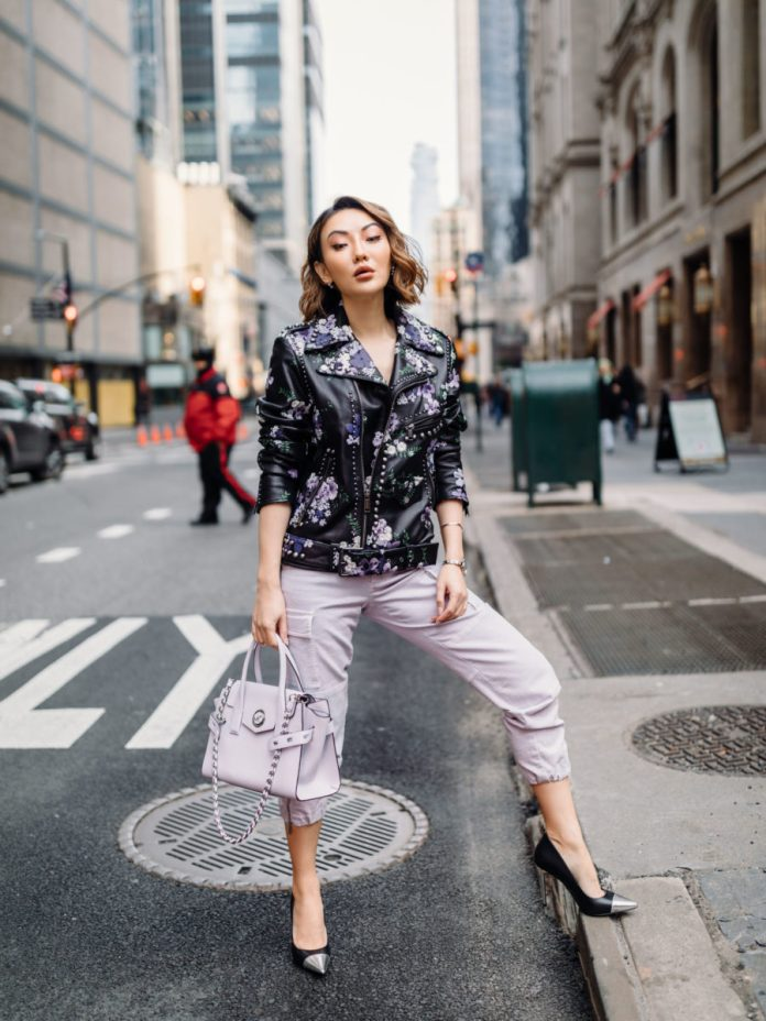 Jessica Wang wearing a studded leather moto jacket, lavender jogger pants, and two tone pumps with a michael kors satchel bag // Jessica Wang - Notjessfashion.com