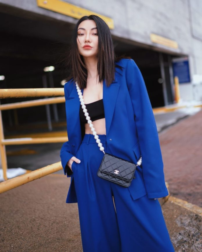 Jessica Wang wearing spring trends from fashion week featuring a blue blazer and blue trousers with a bra top // Jessica Wang - Notjessfashion.com
