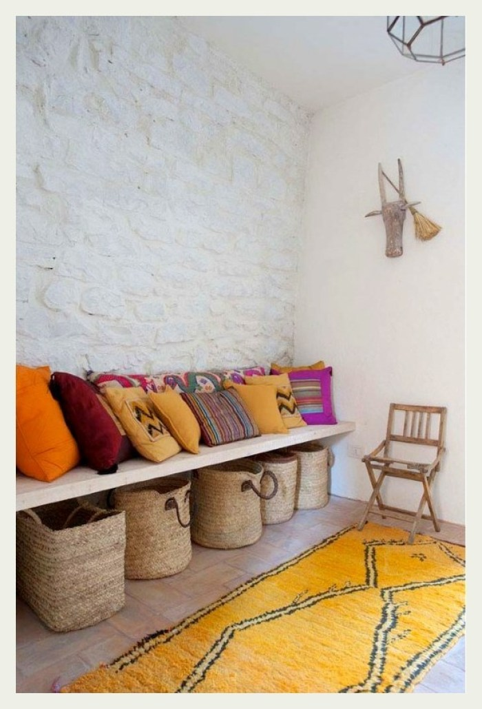 A Textures wall, some cushions and a rug....via
