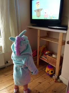 Unicorn dressing gown whilst watching Peppa Pig