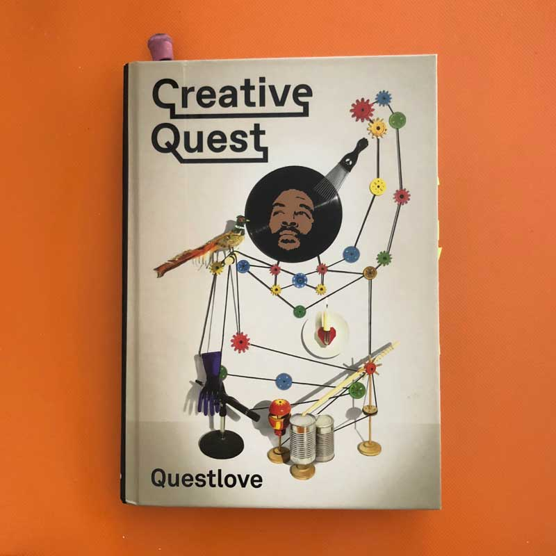 The illustrated cover of Creative Quest on an orange background