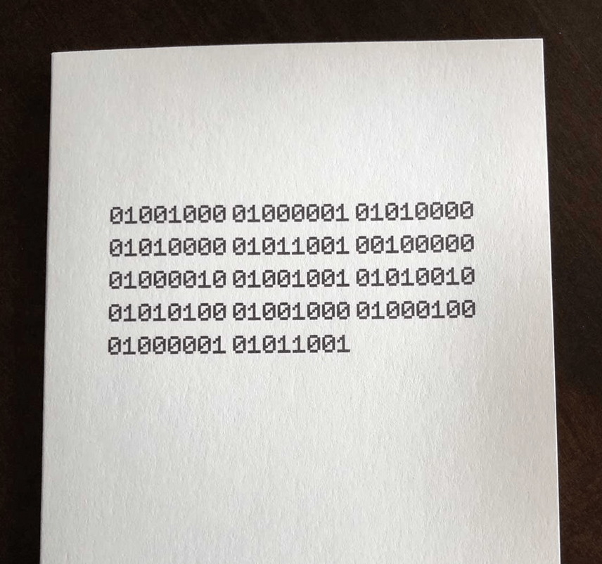 "Image of a card that says ""Happy Birthday"" in binary 1s and 0s"
