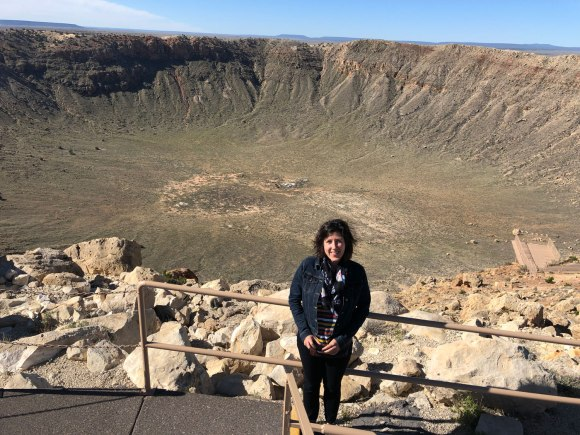 Me standing in front of a giant meteor crater