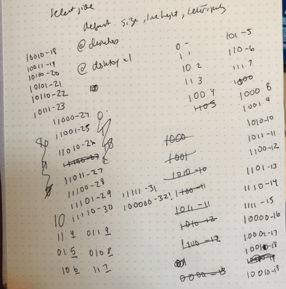 Graph paper with handwriting showing mistakes for counting in binary numbers