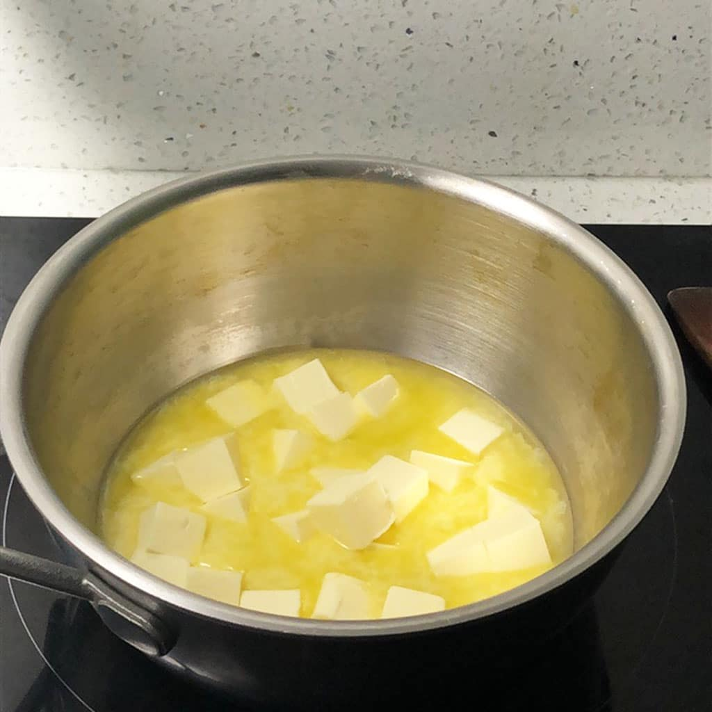 Cubes of butter melting in a saucepan