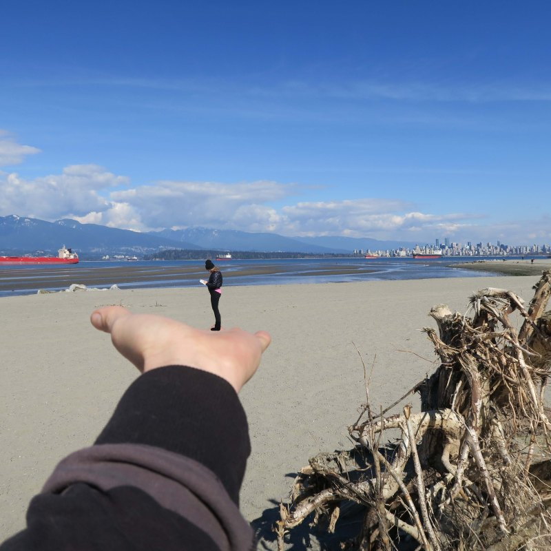 me at beach in mikaels hand_IMG_1081