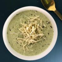Topdown view of Vegan Broccoli Cheese Soup garnished with vegan cheese