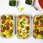Three tinfoil containers of Mexican Corn Chip Casserole