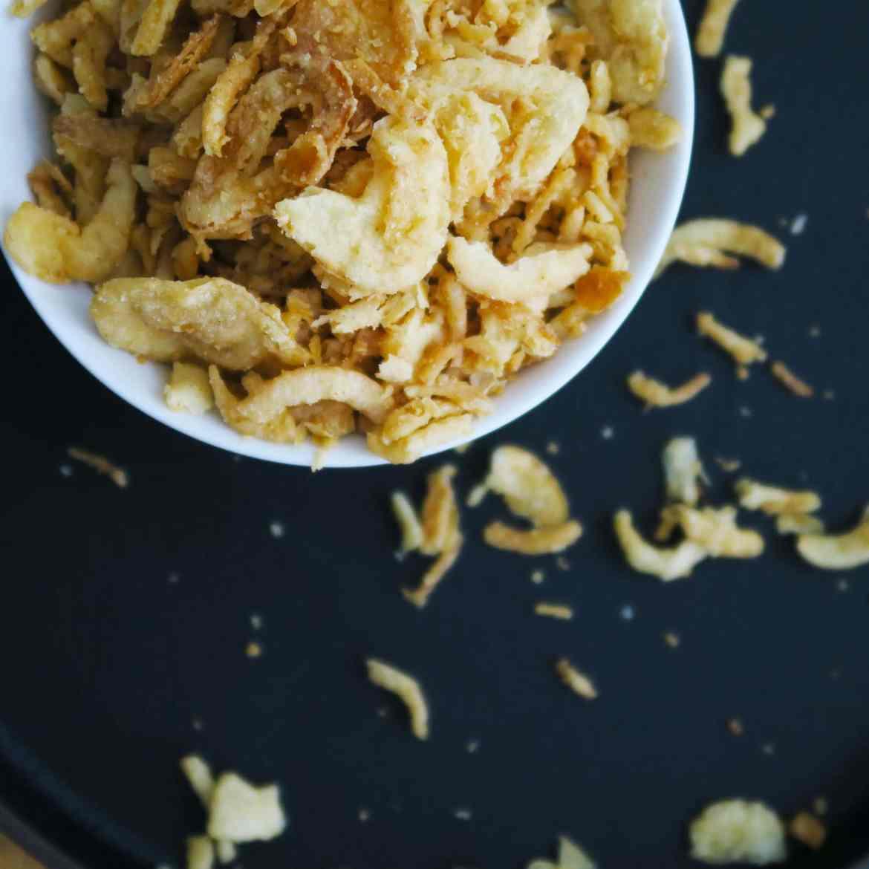 A topdown shot of crispy fried onions - a key ingredient in Vegan Green Bean Casserole.