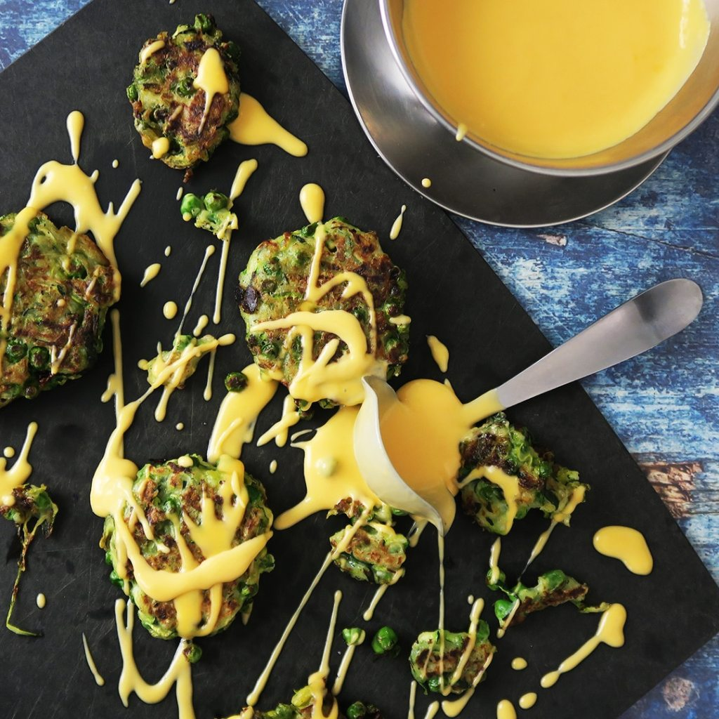 Zucchini and Green Pea Fritters with Cheese Sauce