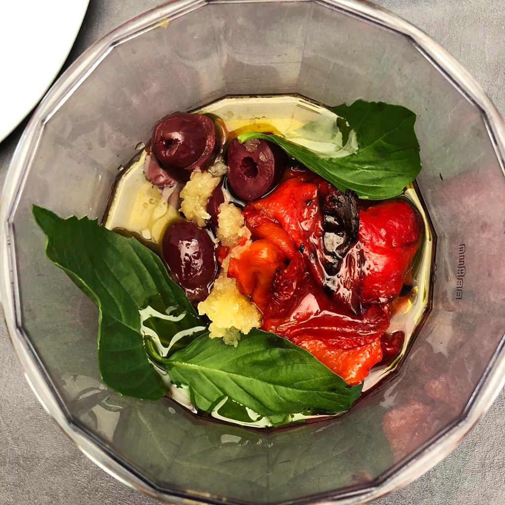 roasted red peppers, olives, basil, garlic, red wine vinegar, olive oil in food chopper jar