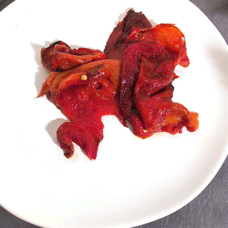 Roasted Red Peppers on a white plate