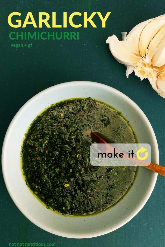 Pin for Garlicky Chimichurri, showing a topdown view of chimchurri in a blue bowl with a small wooden spoon,  all against a dark green background.
