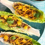 Top-down shot of Zingy Lettuce Wraps - shredded carrots, pineapple, filling in a romaine lettuce