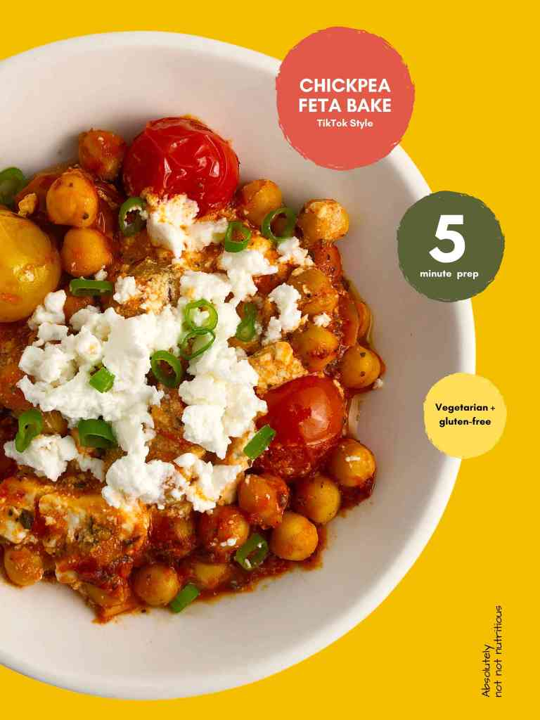 Pinterest graphic for Chickpea Feta Bake. Top down view of bowl with roasted cherry tomatoes, chickpeas, tomato sauce, topped with feta cheese and green onions. Three circles with text: Chickpea Feta Bake - TikTo Style, 5 minute prep, and Vegetarian and Gluten-Free. Absolutely not not nutritious.