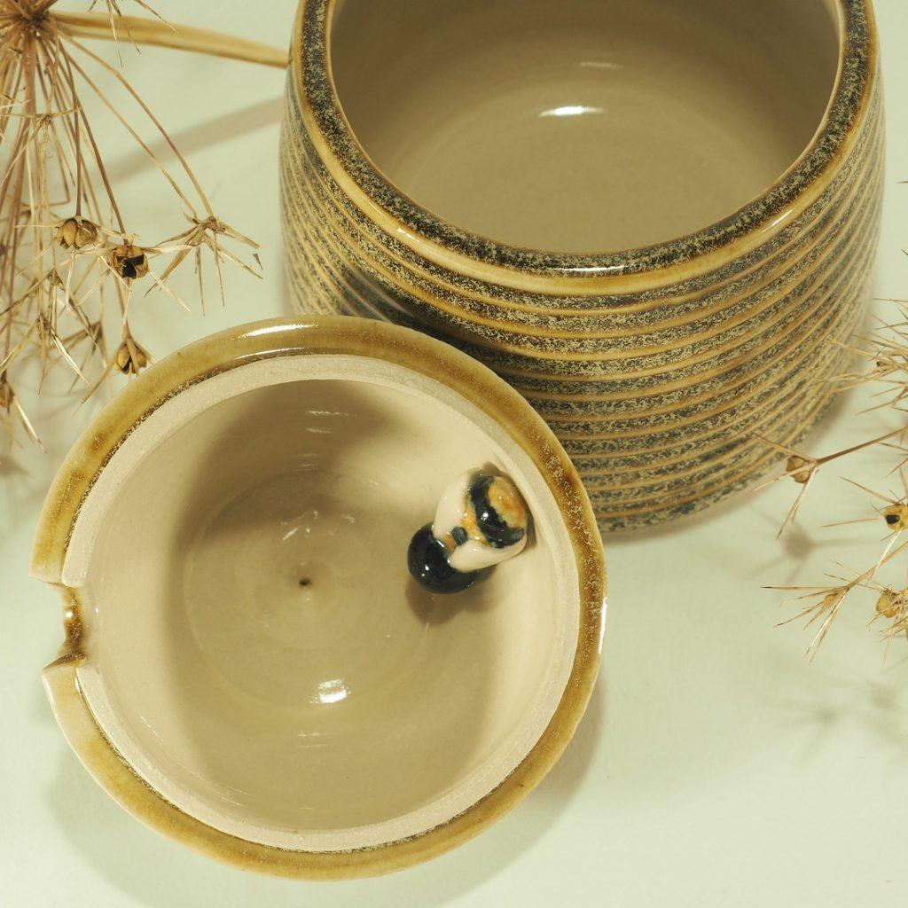 Beehive honey pot with bee inside