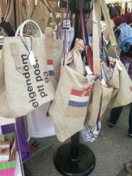 """Lots of stalls have """"upcycled"""" products, these messenger bags are made from old post office mail delivery sacks."""