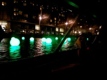 floating lights, that change colour as the boats pass