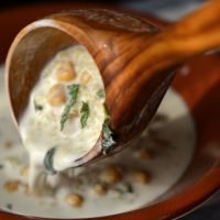 Turkish cold yoghurt soup with wheat, chickpea and mint