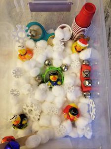 Jingle Bells and Snowballs Sensory Bin - cotton balls and foam snowflakes set a winter scene your tot will love to play with www.pinterest.com/notquitesupermommn