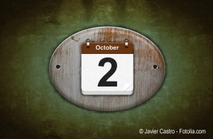 Old wooden calendar with October 2.