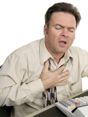 Man sitting at a desk having a heart attack.