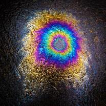 An oil spill on the ground has a rainbow of colors NotSoSAHM