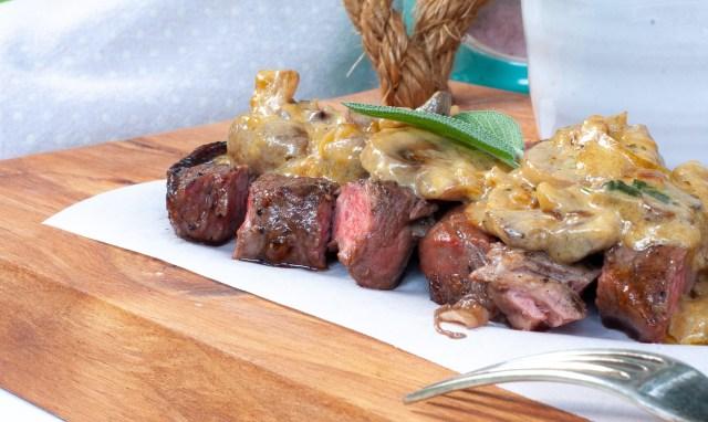 The creamiest mushroom sauce on grilled steak