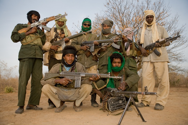 Janjaweed fighters posing with G3s and AK-47s