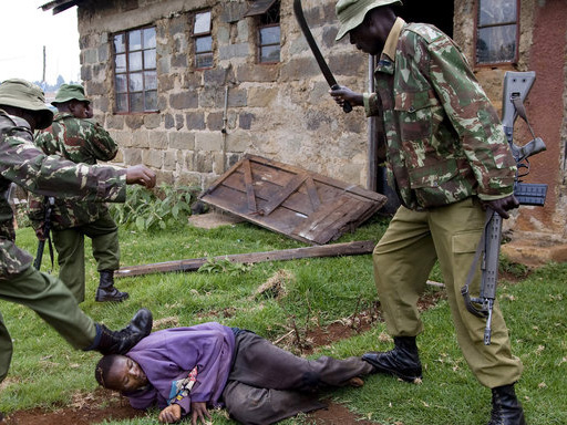A Kenyan policeman with a H&K G3 rifle beating an unarmed man during the post-election unrest on 1st February 2008