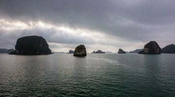 limestone karsts scattered across bai tu long bay vietnam