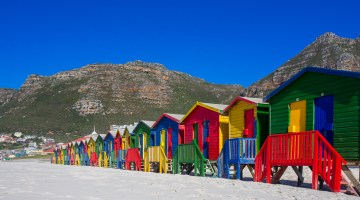 the brightly colored beach houses at muizenberg beach near cape town south africa