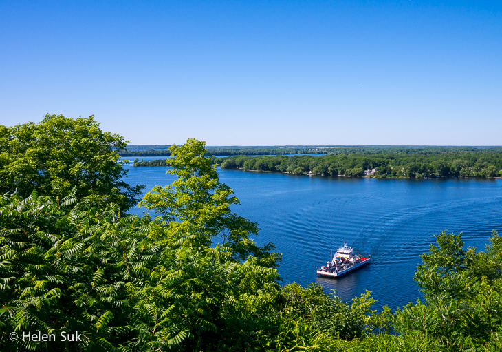 view of a boat in the bay of quinte from lake on the mountain