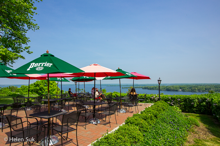 the miller house patio with a picturesque view of the bay of quinte in prince edward county