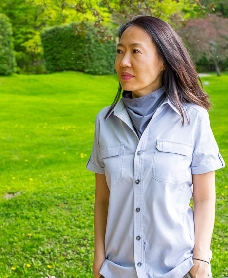 asian woman wearing marks windriver mosquito repellent clothes