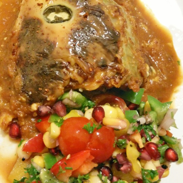 Succulent cabbage rolls stuffed with mince served with a 3 pepper and corn salad