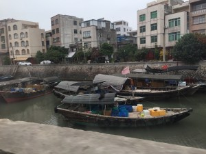 Beihai is a coastal town, and we drove by TONS of these boats tied up - it's not clear how anyone actually gets their boats out of this area...